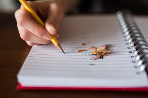 empty notebook with pencil shavings; writing apps can eliminate those blank pages