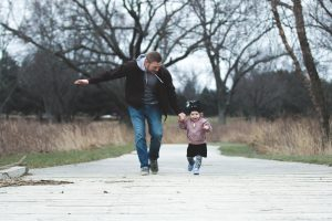dad walking with little one