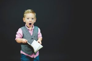 boy excited about book