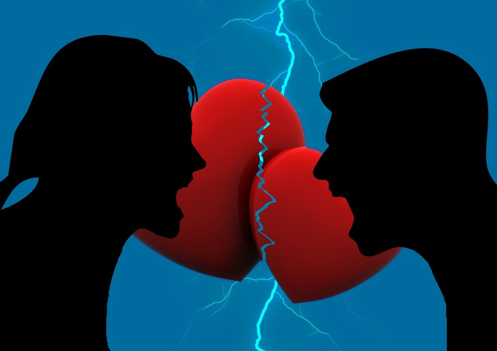 man and woman experiencing hate in the heart