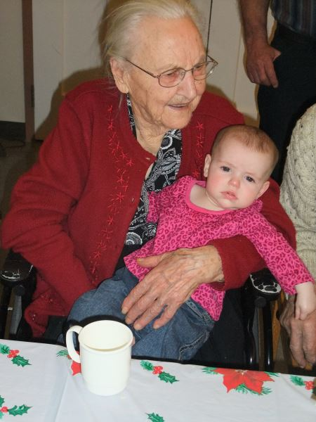 My grandmother holding my youngest daughter