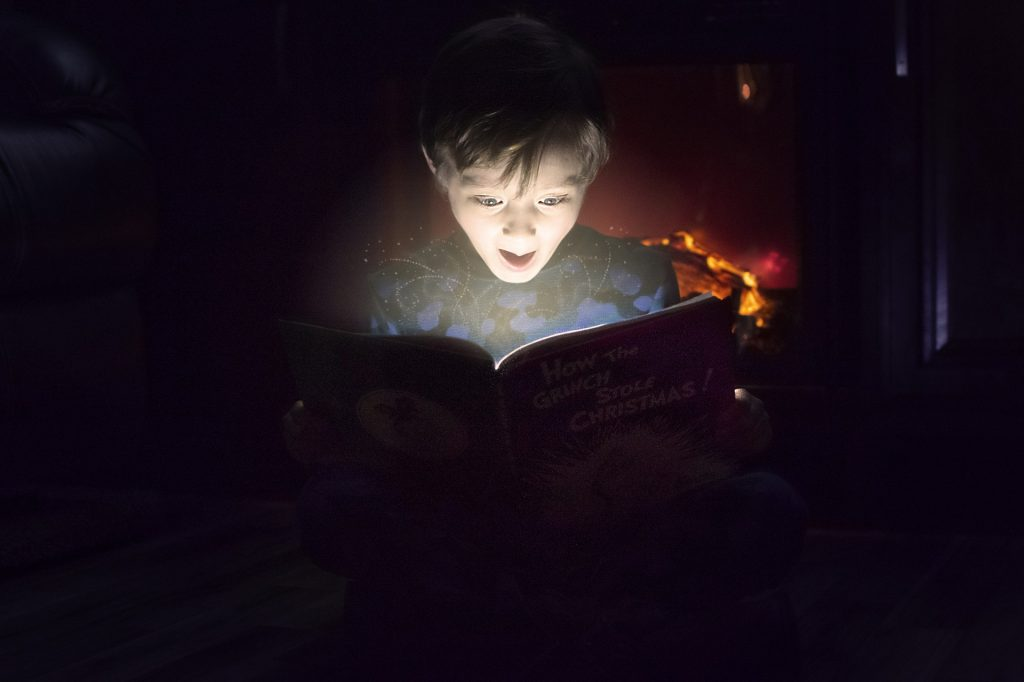 boy excited about what he is reading; strategies for improving reading comprehension