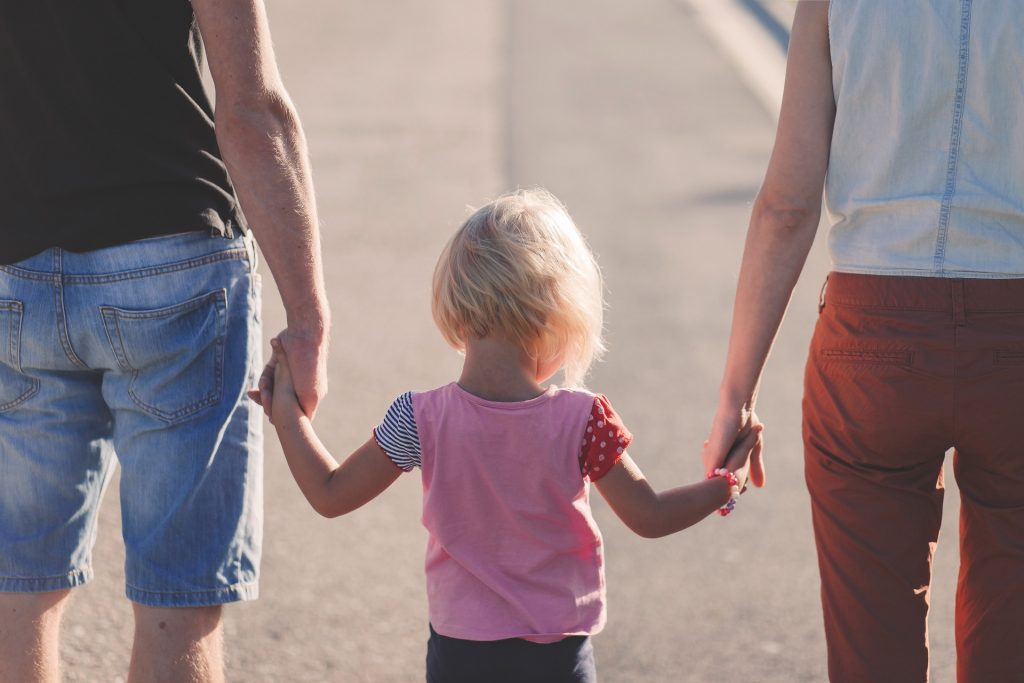 parents walking with their little one... challenges of parenting